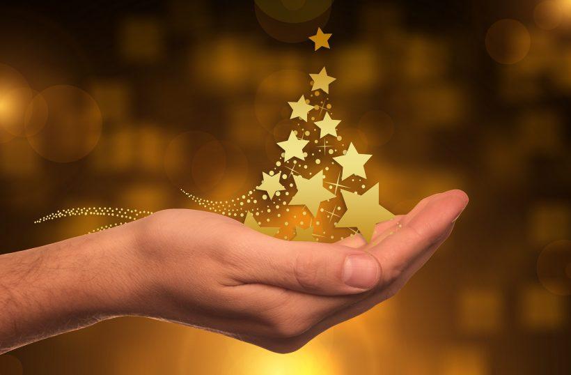 Hand with Christmas stars